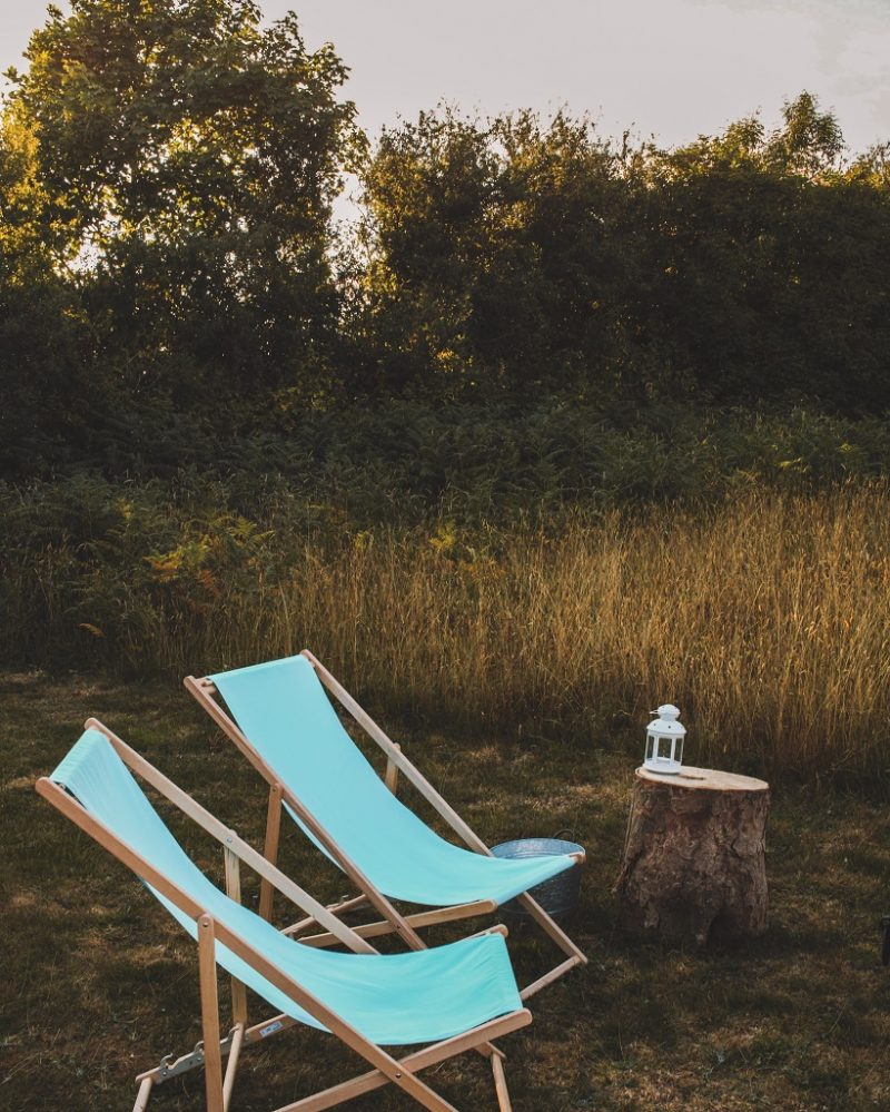Outdoor seating at Wild Wellingtons Meadow Dome