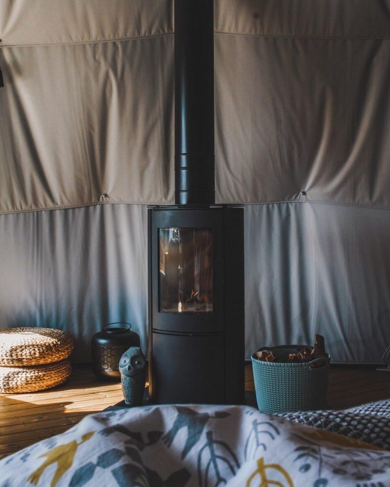 Wood burner inside Meadow Dome